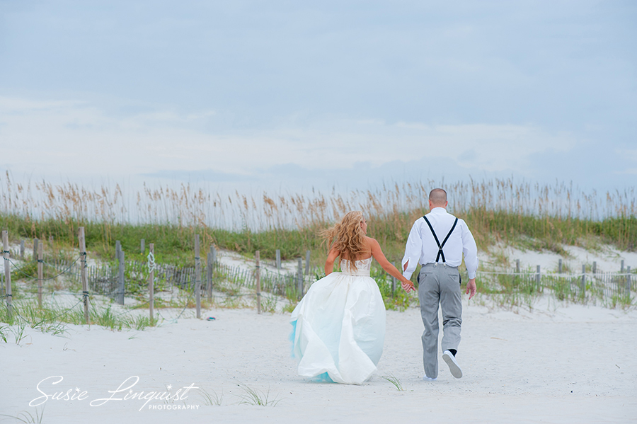bride and groom beach exit